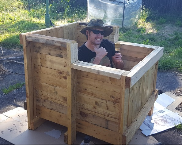 Christopher Pickering building an aquaponic fish tank from recycled materials